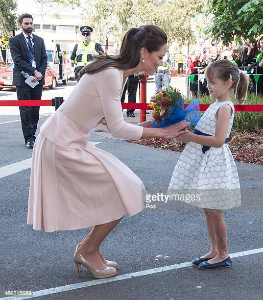 Catherine Duchess of Cambridge meets six year old Lauren Stepherson during their visit to Elizabeth on April 23 2014 in Adelaide Australia The Duke...