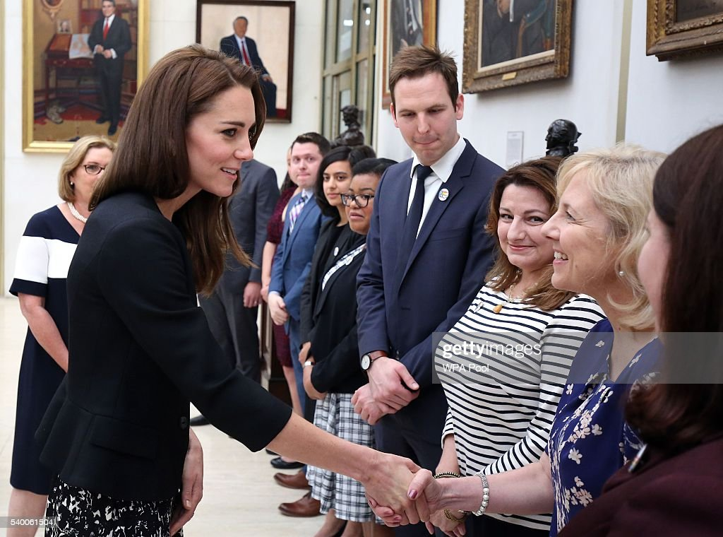 Catherine, Duchess of Cambridge meets staff after she signed a book of condolence for Orlando mass shooting victims at the US Embassy on June 14, 2016 in London, England.
