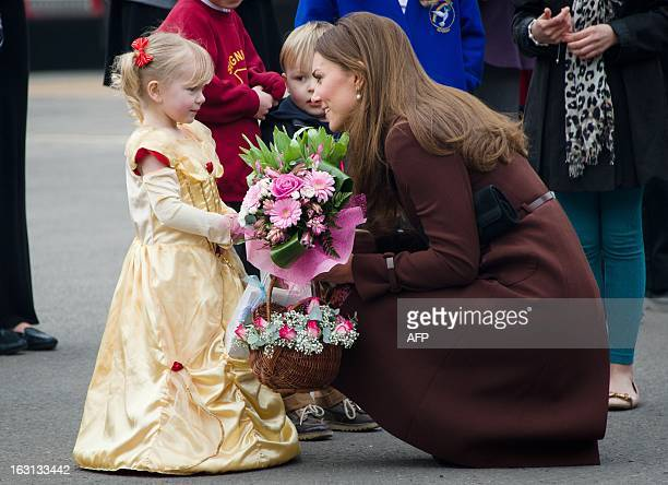 Catherine Duchess of Cambridge meets threeyearold Isobelle Laursen during a visit to Peaks Lane fire station in Grimsby northern England on March 5...