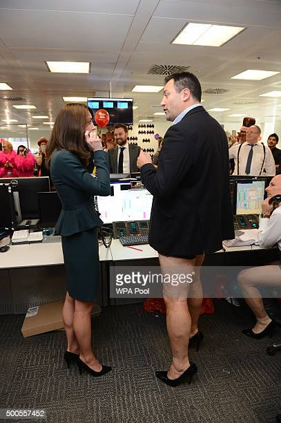 Catherine, Duchess of Cambridge meets trader Nigel Hallagan as she and Prince William, Duke of Cambridge attend the ICAP charity day at ICAP on...