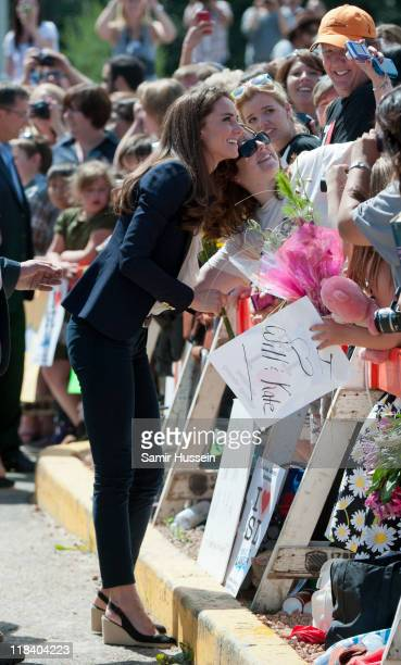 Catherine Duchess of Cambridge meets well wishers as she visits a part of town devastated by a fire in May 2011 on July 7 2011 in Slave Lake Alberta