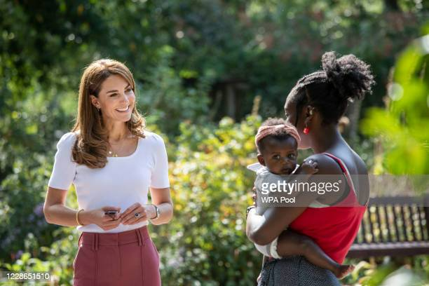 Catherine, Duchess of Cambridge meets with MUSH mother and baby group member, Morgan Alex Cassius and her 6 month old, Makena Grace as she hears from...