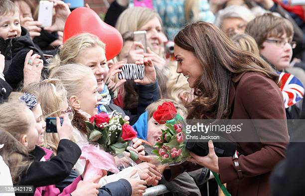 Catherine Duchess of Cambridge meets young girls as she visits Alder Hey Children's NHS Foundation Trust on February 14 2012 in Liverpool England The...