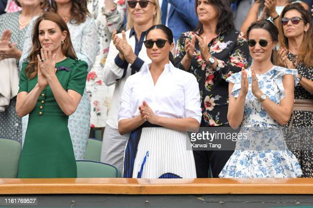 Catherine, Duchess of Cambridge, Meghan, Duchess of Sussex and Pippa Middleton in the Royal Box on Centre Court during day twelve of the Wimbledon...