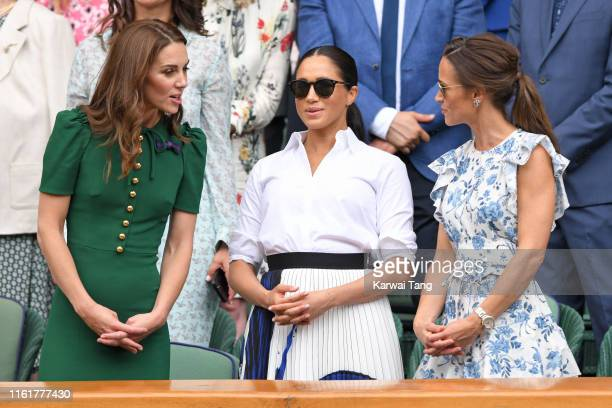 Catherine Duchess of Cambridge Meghan Duchess of Sussex and Pippa Middleton in the Royal Box on Centre Court during day twelve of the Wimbledon...