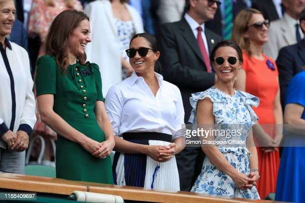 Catherine Duchess of Cambridge Meghan Duchess of Sussex and Pippa Matthews share some laughter in the Royal Box on Centre Court on Day 12 of The...