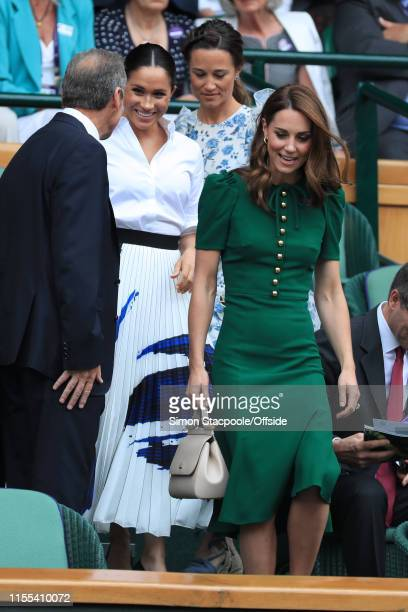 Catherine Duchess of Cambridge Meghan Duchess of Sussex and Pippa Matthews arrive in the Royal Box to watch the Ladies' Singles Final on Day 12 of...