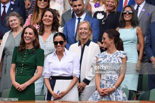 Catherine Duchess of Cambridge Meghan Duchess of Sussex and Pippa Middleton react in the Royal Box after the Ladies' Singles final against during Day...