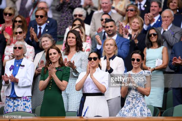 Catherine Duchess of Cambridge Meghan Duchess of Sussex and Pippa Middleton applaud from the Royal Box after the Ladies' Singles final against during...