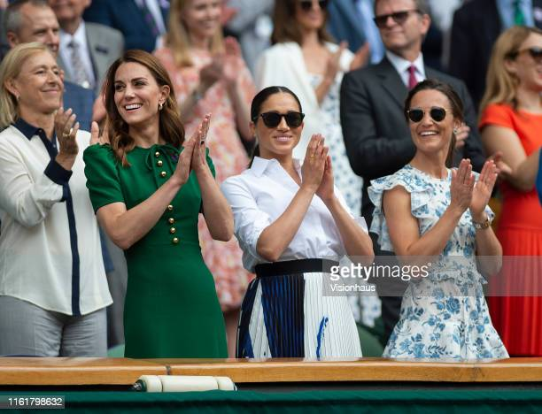 Catherine Duchess of Cambridge Meghan Duchess of Sussex and Pippa Matthews applaud the presentation after the Final of the Ladies Singles on Day...