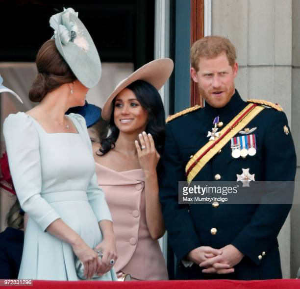 Catherine Duchess of Cambridge Meghan Duchess of Sussex and Prince Harry Duke of Sussex stand on the balcony of Buckingham Palace during Trooping The...