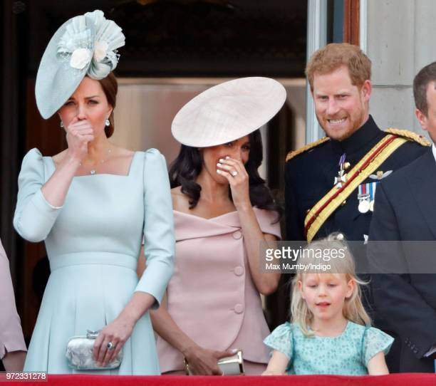Catherine Duchess of Cambridge Meghan Duchess of Sussex Prince Harry Duke of Sussex and Isla Phillips stand on the balcony of Buckingham Palace...