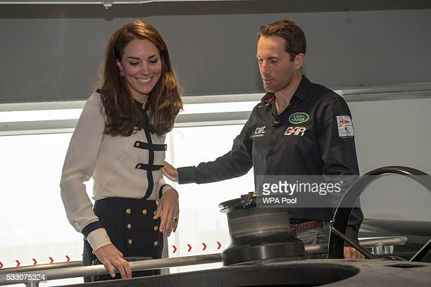 Catherine, Duchess of Cambridge, patron of the 1851 Trust, talks with Sir Ben Ainslie as she visits the Land Rover BAR team, who are challenging for...