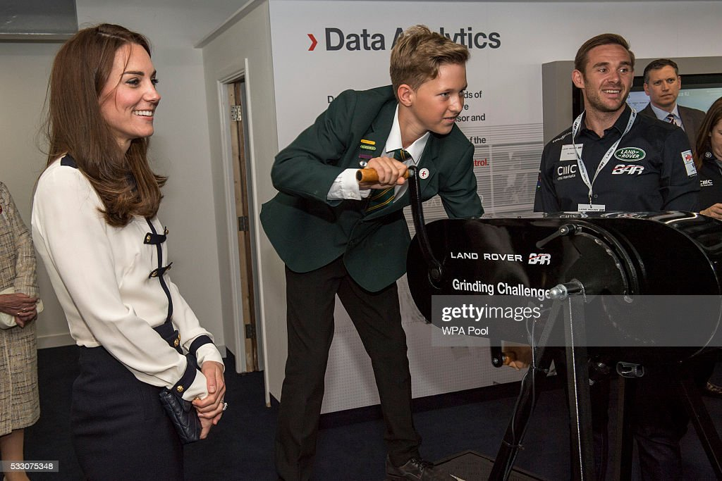 Catherine, Duchess of Cambridge, patron of the 1851 Trust, watches Oliver Matthews, 12, use the grinder winch as she tours the new 'Tech Deck' Education Centre during her visit to the Land Rover BAR team, who are challenging for the 2017 America's Cup, on May 20, 2016 in Portsmouth, England. The Duchess of Cambridge is launching the 1851 Trust's two sailing projects and meeting people involved in the project. Afterwards she will open the 'Tech Deck' Education Centre at the heart of the base.