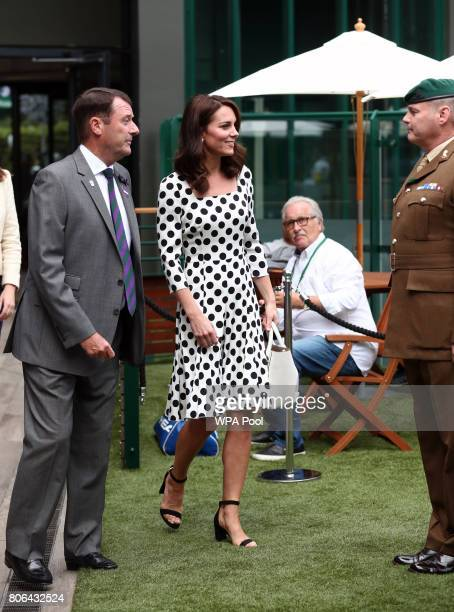 Catherine Duchess of Cambridge Patron of the All England Lawn Tennis and Croquet Club with AELTC Chairman Philip Brook as she meets servicemen and...