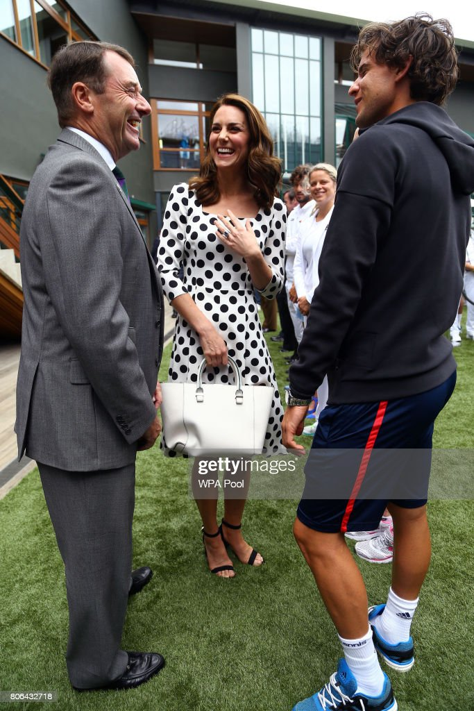 Catherine, Duchess of Cambridge, Patron of the All England Lawn Tennis and Croquet Club (AELTC) with AELTC Chairman Philip Brook (L) as they meet Austrain tennis player Dominic Thiem on day one of the Wimbledon Championships at The All England Lawn Tennis and Croquet Club, in Wimbledon on July 3, 2017 in London, England.
