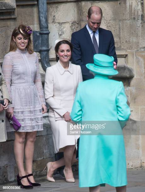 Catherine, Duchess of Cambridge performs a curtsy to Queen Elizabeth II as she attends Easter Day Service with Prince William, Duke of Cambridge and...