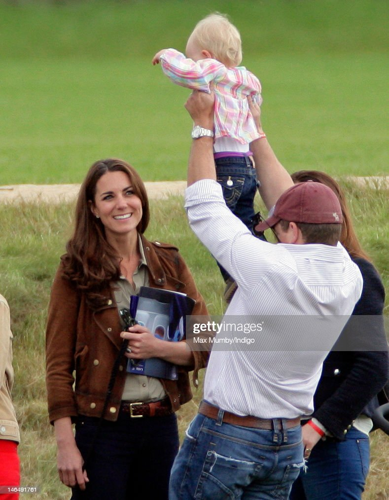 Catherine, Duchess of Cambridge, Peter Phillips and Savannah Phillips attend The Golden Metropolitan Polo Club Charity Cup polo match, in which Prince William, Duke of Cambridge and Prince Harry played, at the Beaufort Polo Club on June 17, 2012 in Tetbury, England.