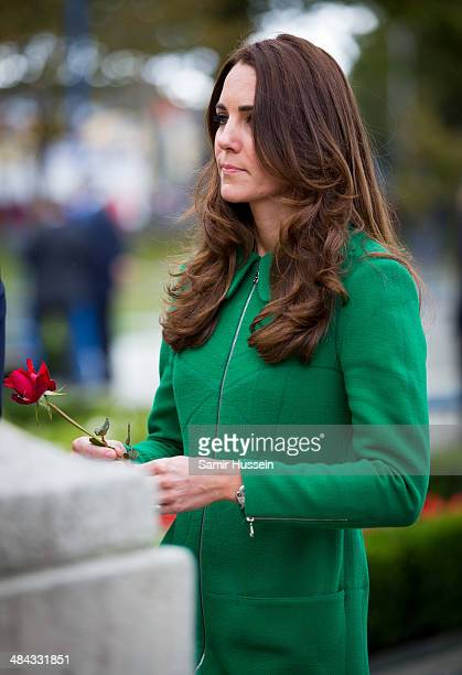 Catherine Duchess of Cambridge places a flower on the War Memorial as she visits the Cambridge Town Hall on April 12 2014 in Hamilton New Zealand The...