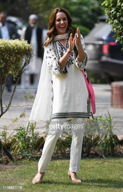 Catherine Duchess of Cambridge plays cricket on a visit to the SOS Village on October 18 2019 in Lahore Pakistan