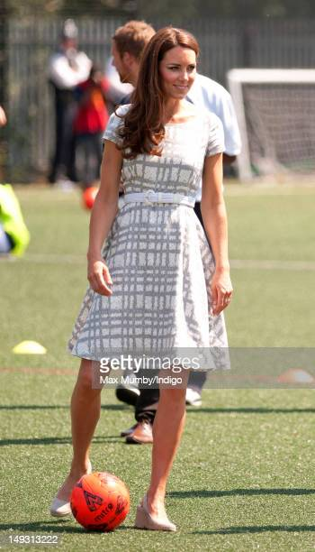 Catherine Duchess of Cambridge plays football as she visits Bacon's College on July 26 2012 in London England