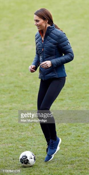 Catherine Duchess of Cambridge plays football during a visit to Windsor Park Stadium home of the Irish Football Association on February 27 2019 in...