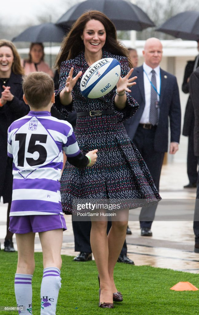 Catherine, Duchess of Cambridge plays rugby with young French rugby fans at the Trocadero square near the Eiffel Tower on March 18, 2017 in Paris, France. The Duke and Duchess are on a two day tour of France.