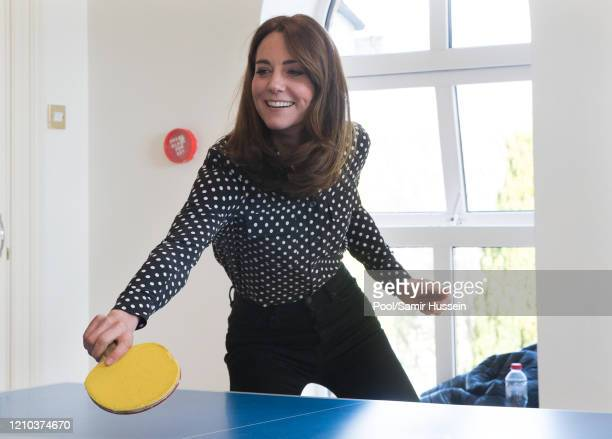 Catherine Duchess of Cambridge plays table tennis as she visits Savannah House a residential facility run by charity Extern in County Meath north of...