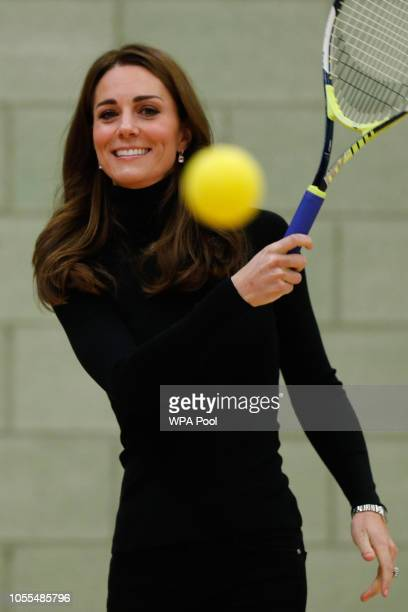 Catherine Duchess of Cambridge plays tennis as she joins a session with a group as they join a session during a visit to the Coach Core Essex...