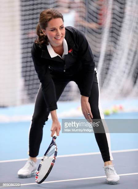 Catherine Duchess of Cambridge plays tennis during a visit to the Lawn Tennis Association at the National Tennis Centre on October 31 2017 in London...
