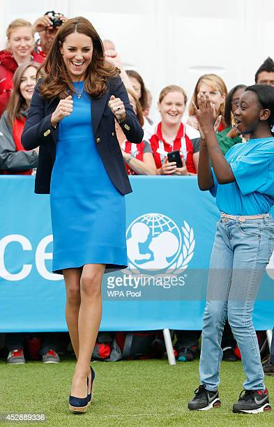 Catherine Duchess of Cambridge plays the South African game of Three Tins during a visit to the Commonwealth Games Village on July 29 2014 in Glasgow...