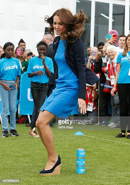 Catherine, Duchess of Cambridge plays the South African game of Three Tins during a visit to the Commonwealth Games Village on July 29, 2014 in...