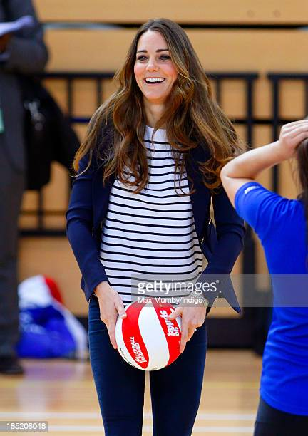 Catherine Duchess of Cambridge plays volleyball as she attends a SportsAid Athlete Workshop in the Copper Box Arena at the Queen Elizabeth Olympic...