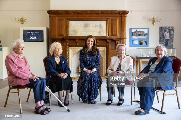 Catherine Duchess of Cambridge poses for a photograph with veterans Elizabeth Diacon Georgina Rose Audrey Mather and Rena Stewart during a visit to...
