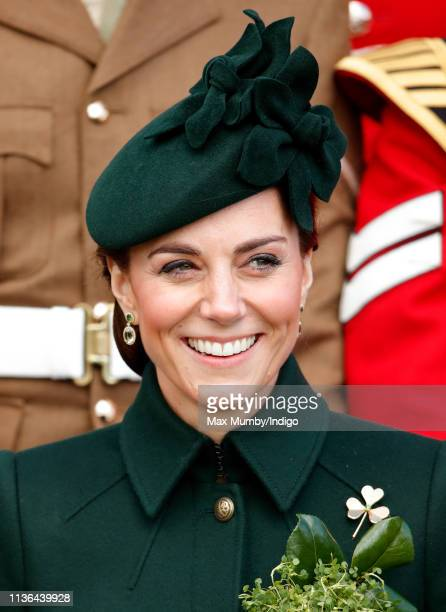 Catherine Duchess of Cambridge poses for a regimental photograph as she attends the 1st Battalion Irish Guards St Patrick's Day Parade at Cavalry...