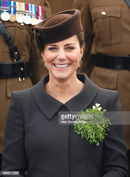 Catherine Duchess of Cambridge poses for a regimental photograph as she attends the annual St Patrick's Day Parade at Mons Barracks on March 17 2015...
