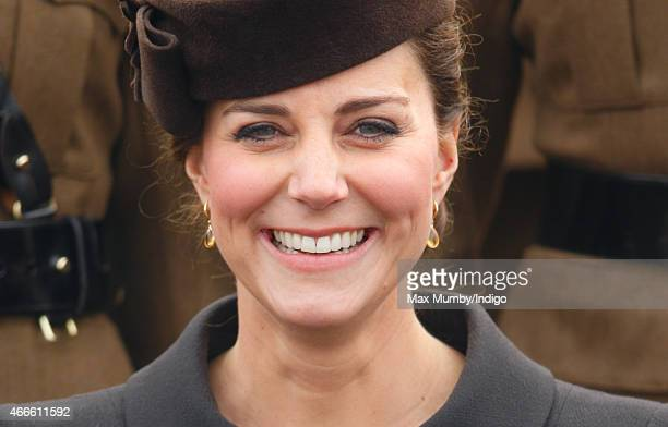 Catherine, Duchess of Cambridge poses for a regimental photograph as she attends the annual St Patrick's Day Parade at Mons Barracks on March 17,...