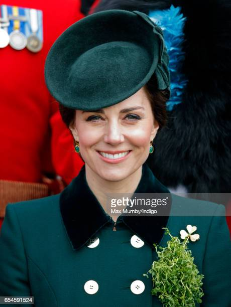 Catherine Duchess of Cambridge poses for a regimental photograph with soldiers of the Irish Guards during the annual St Patrick's Day Parade at...
