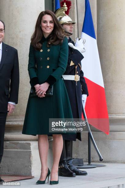 Catherine Duchess of Cambridge poses not far from her husband Prince William Duke of Cambridge before their meeting with French President Francois...