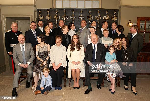 Catherine, Duchess of Cambridge poses with cast, crew and producers of Downton Abbey during an official visit to the set of Downton Abbey at Ealing...