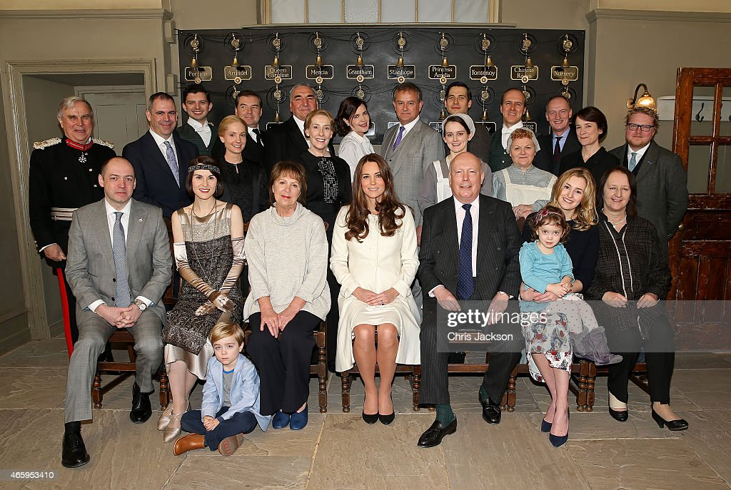 Catherine, Duchess of Cambridge (C) poses with cast, crew and producers of Downton Abbey during an official visit to the set of Downton Abbey at Ealing Studios on March 12, 2015 in London, England.
