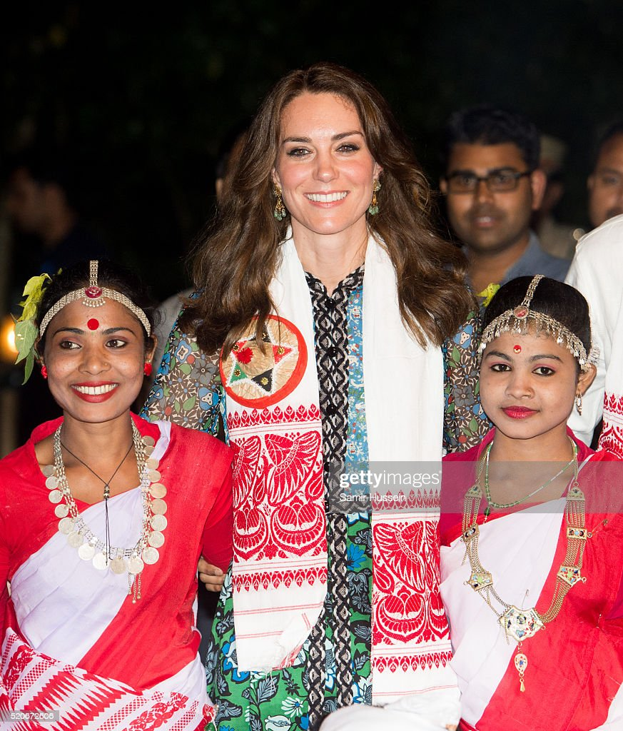 Catherine, Duchess of Cambridge poses with dancers during a Bihu Festival Celebration at Diphlu River Lodge atKaziranga National Park on April 12, 2016 in Guwahati, India.