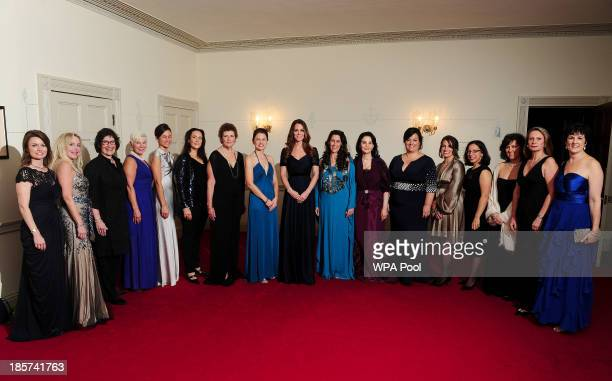 Catherine Duchess of Cambridge poses with members of the Board of 100 Women in Hedge Funds at a gala dinner in aid of Action on Addiction hosted by...