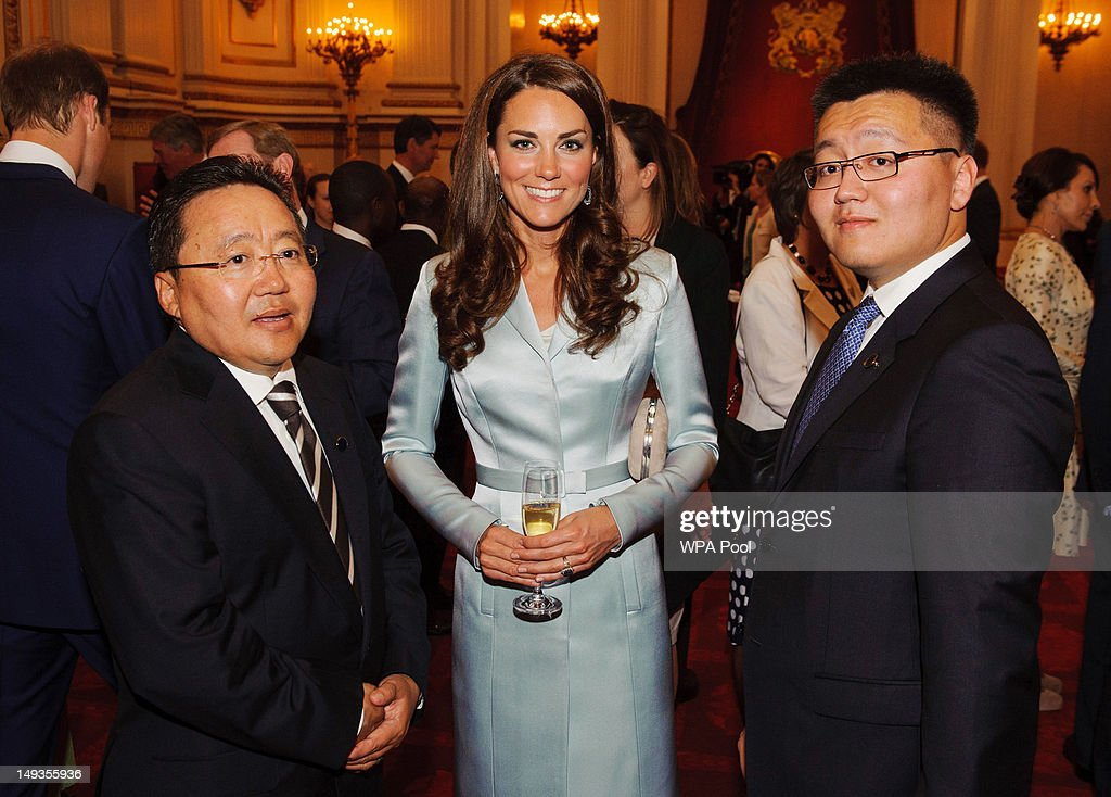 Catherine, Duchess of Cambridge poses with President of Mongolia Elbegdorj Tsakhia (L) during a reception at Buckingham Palace a reception for Heads of State and Government attending the Olympics Opening Ceremony on July 27, 2012 in London, England.