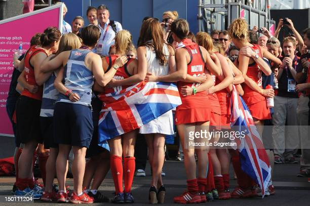 Catherine, Duchess of Cambridge poses with Team GB after their Women's Hockey bronze medal match against New Zealand on Day 14 of the London 2012...