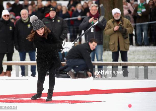 Catherine Duchess of Cambridge practices penalty shots with the Stockholm bandy team Hammarby IF where they will learn more about the popularity of...