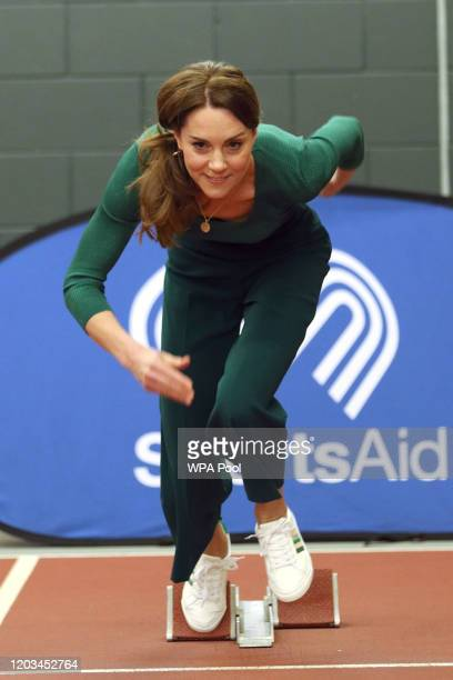 Catherine, Duchess of Cambridge prepares to exit the starting blocks during a SportsAid Stars event at the London Stadium in Stratford on February...