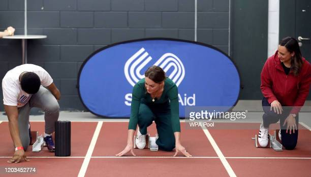 Catherine, Duchess of Cambridge prepares to race against para-athlete sprinter Emmanuel Oyinbo-Coker and heptathlete Jessica Ennis-Hill during a...