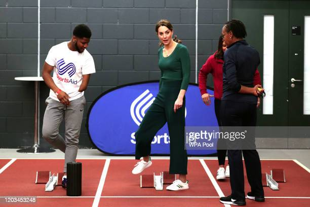 Catherine Duchess of Cambridge prepares to race against paraathlete sprinter Emmanuel OyinboCoker and heptathlete Jessica EnnisHill during a...