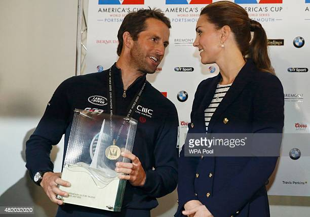Catherine Duchess of Cambridge presents a trophy to Sir Ben Ainslie skipper of Britain's Land Roverbacked BAR team at the close of the British leg of...